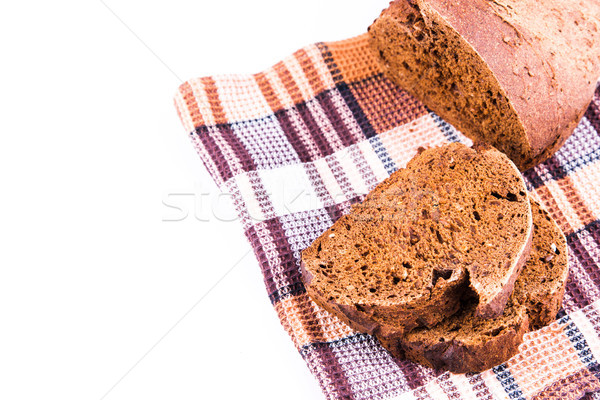Fresh sliced homemade brown bread with cereals on a kitchen towel Stock photo © Len44ik