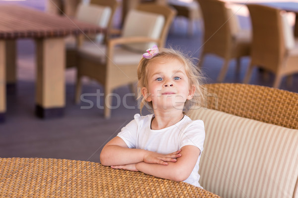 Cute little child at the table in a restaurant Stock photo © Len44ik