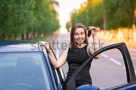 Gyönyörű üzletasszony autó nő mögött kerék Stock fotó © Len44ik