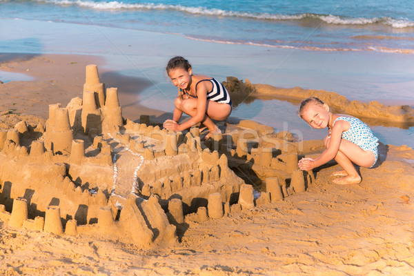 Adorable little girls playing at the seashore Stock photo © Len44ik