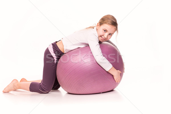 Sportive girl on a fit ball isolated over white Stock photo © Len44ik