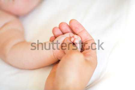 Father holding the hand of his new born son Stock photo © Len44ik