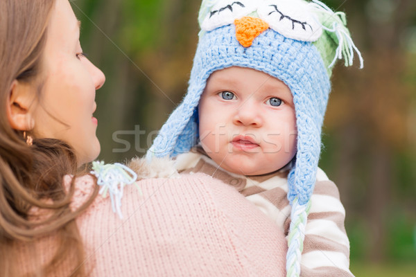 Mother holding adorable little baby outdoor Stock photo © Len44ik