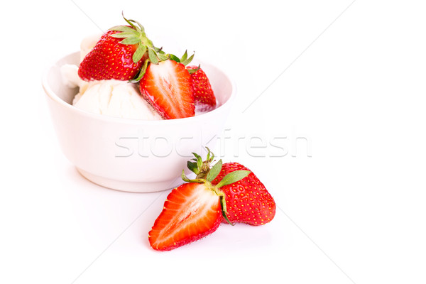 Fresh ice cream in a plate with strawberry isolated on white Stock photo © Len44ik