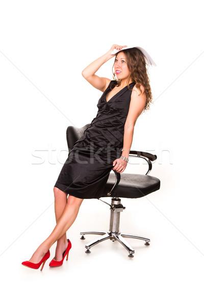 Attractive businesswoman studying paperwork  Stock photo © Len44ik