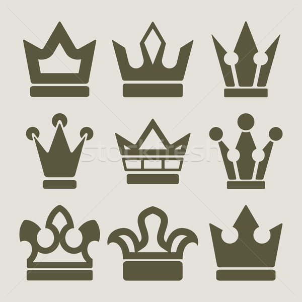 Stock photo: Vector set of crown shapes on beige background.