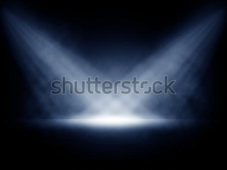 Stock photo: Stage lights with smoky effect background.