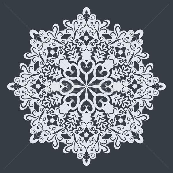 Big white ornamental snowflake on black background. Christmas de Stock photo © lenapix
