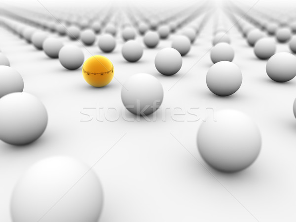 Golden ball surrounded by white ones with the focus on it. Stock photo © lenapix