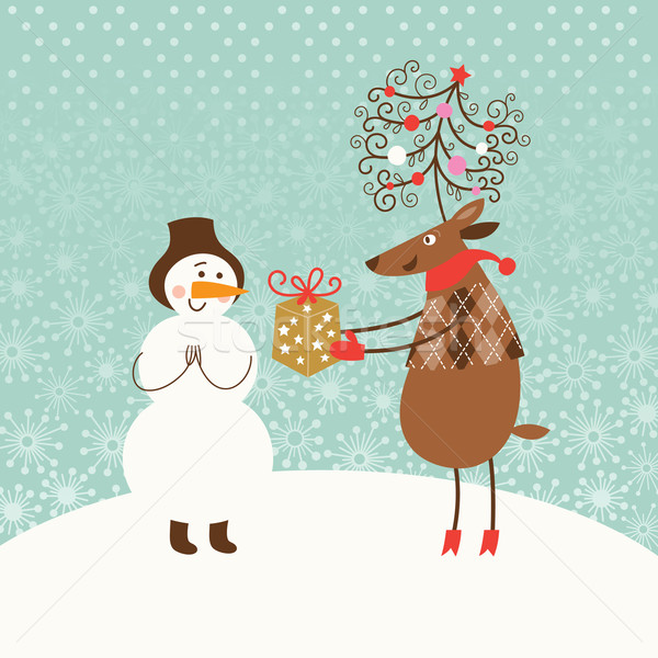 Cute Christmas deer gives a gift for Snowman  Stock photo © Lenlis