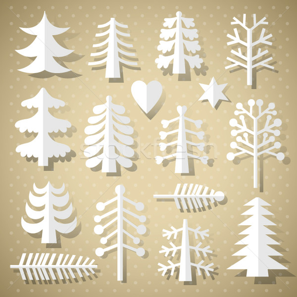 Stock photo: Cutting Christmas trees of white paper