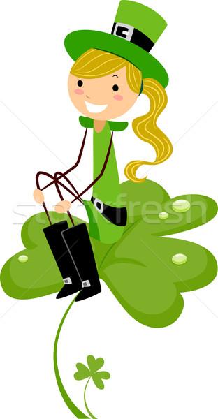 Girl on Shamrock Stock photo © lenm