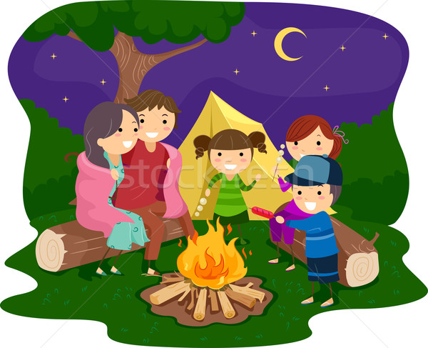 Aile şenlik ateşi örnek etrafında kadın adam Stok fotoğraf © lenm