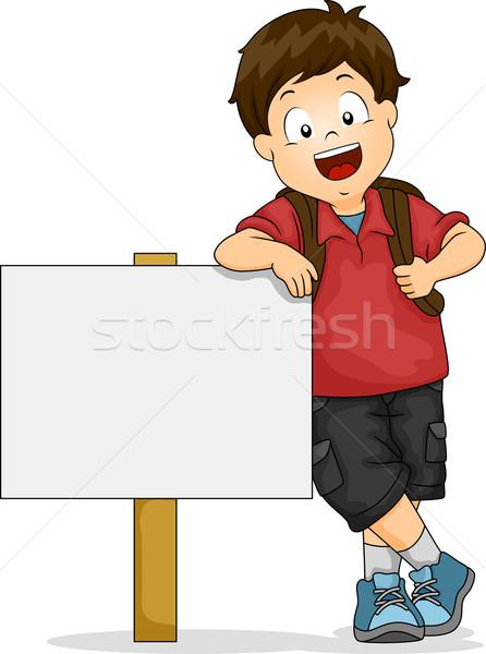 Kid Boy Leaning on Blank Signboard Stock photo © lenm