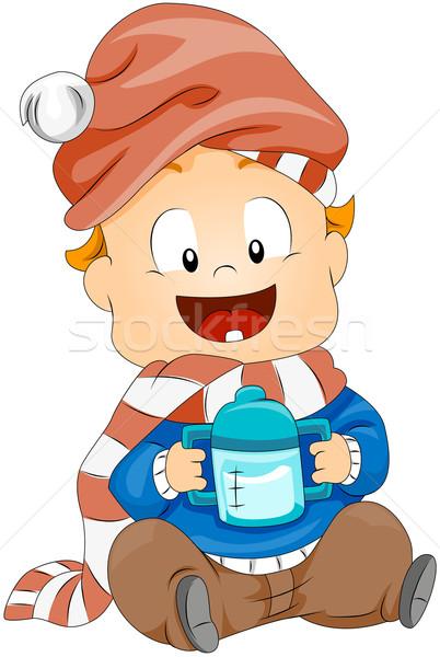 Toddler holding Milk Bottle Stock photo © lenm