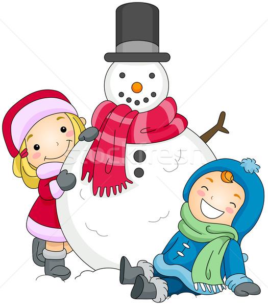 Kids Posing Beside a Snowman Stock photo © lenm