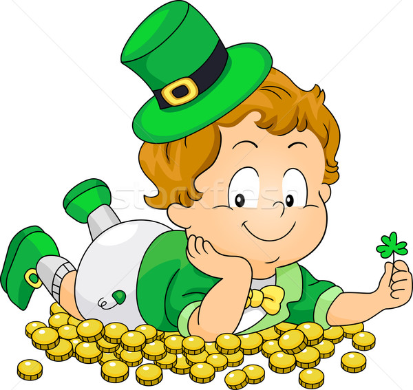 Kid Lying on Gold Coins Stock photo © lenm