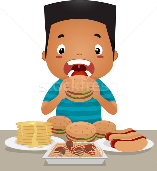 Binge Eating Boy Stock photo © lenm