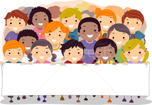Children Holding a Banner Stock photo © lenm