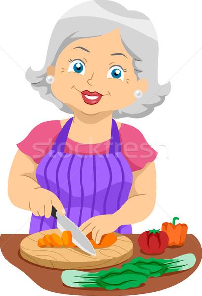 Senior Slicing Veggies Stock photo © lenm