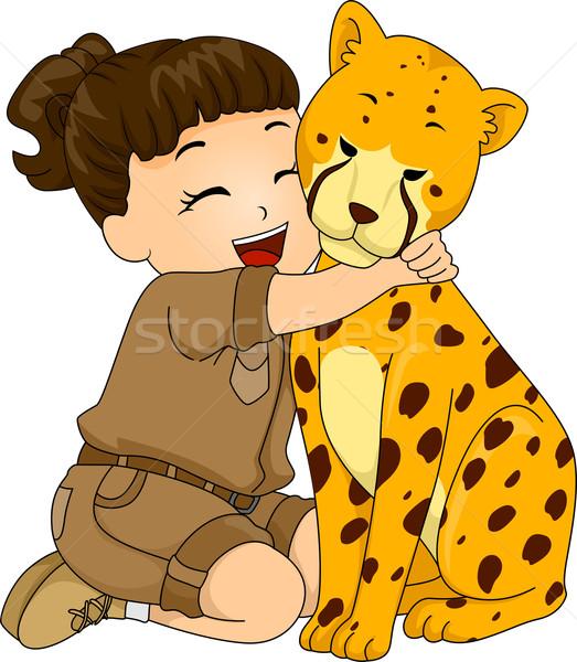 Girl Hugging Cheetah Stock photo © lenm