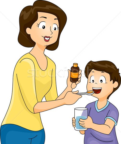 Mom Giving Son Vitamins Stock photo © lenm