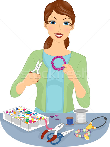 Girl Making Jewellery Stock photo © lenm