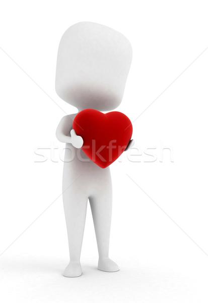 Man Holding a Heart Stock photo © lenm