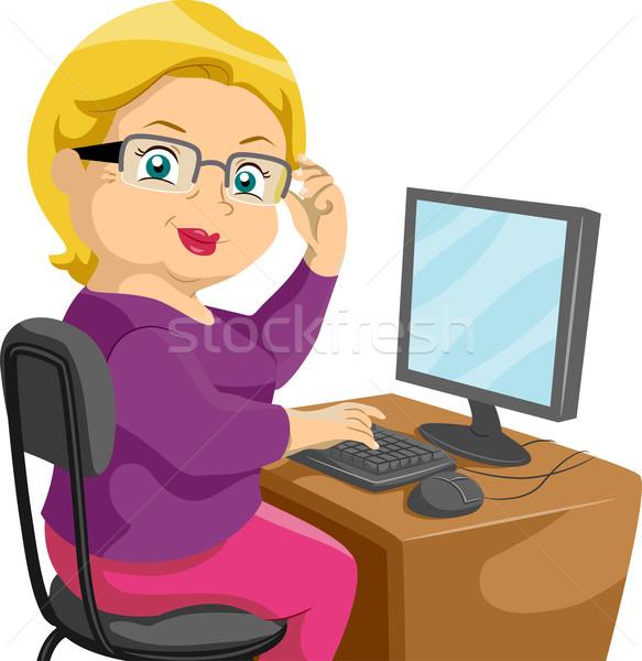 Senior Using a Computer Stock photo © lenm