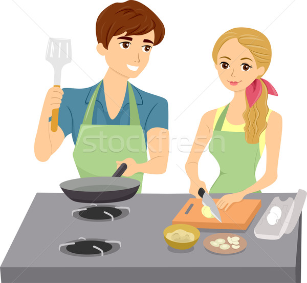 Couple Cooking with Matching Aprons Stock photo © lenm