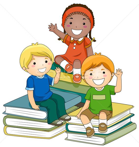 Gyerekek könyvek kis csoport ül lány gyerekek Stock fotó © lenm