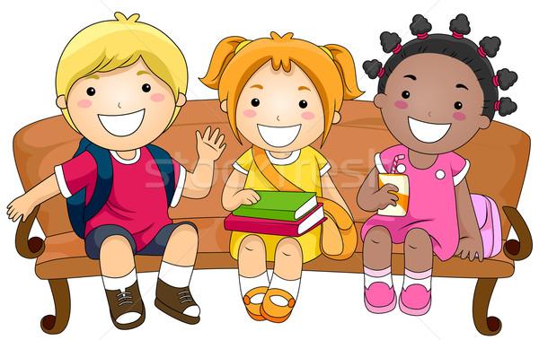 Kids Sitting on a Bench Stock photo © lenm