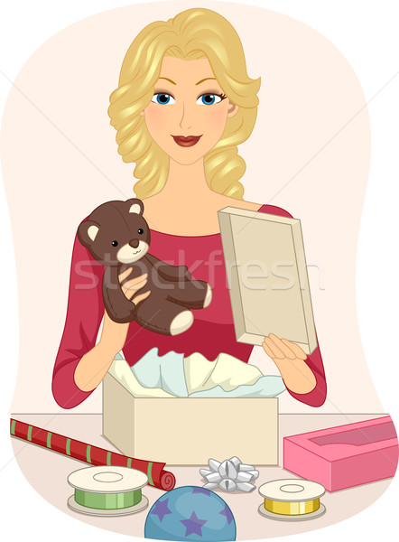 Girl Wrapping Toy Stock photo © lenm