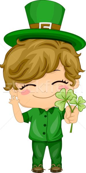 Boy Holding Shamrocks Stock photo © lenm