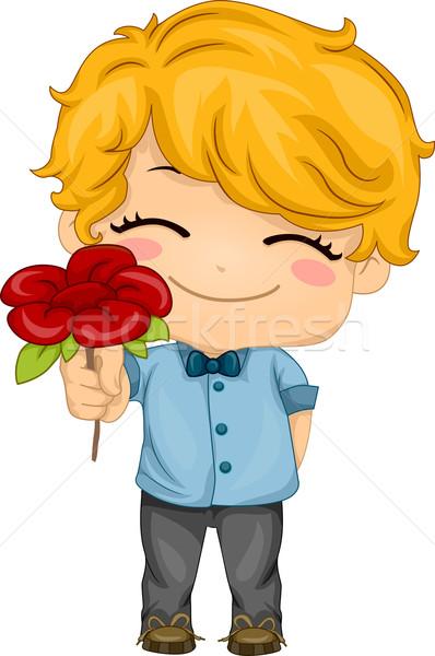 Boy Presenting a Flower Stock photo © lenm