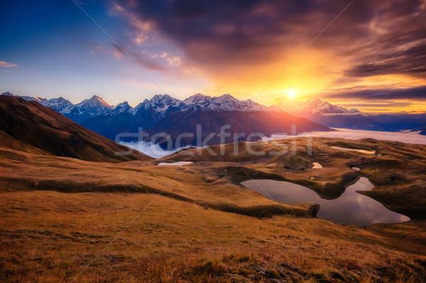Fantasztikus hegy tájkép tó égbolt láb Stock fotó © Leonidtit