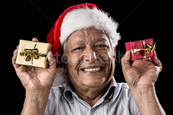 Smiling Aged Man Holding Two Small Xmas Gifts Stock photo © leowolfert