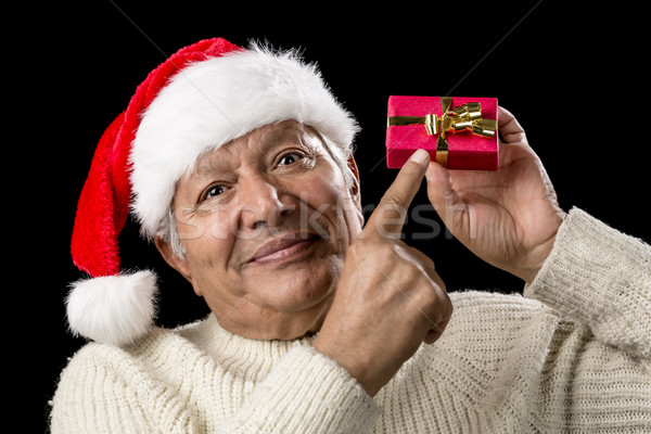 Male Senior With Red Pompom Hat And Christmas Gift Stock photo © leowolfert