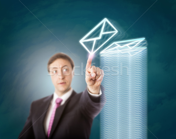 Overworked Manager Stacking Virtual Documents Stock photo © leowolfert
