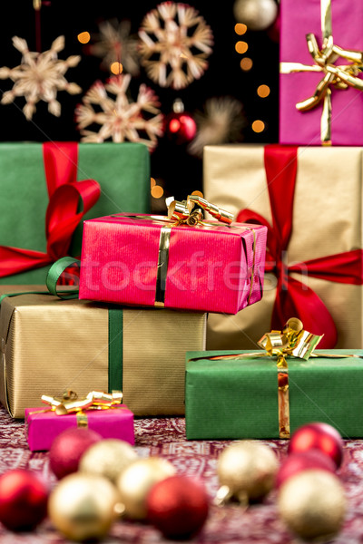 Xmas Gifts Between Ornaments and Stars Stock photo © leowolfert