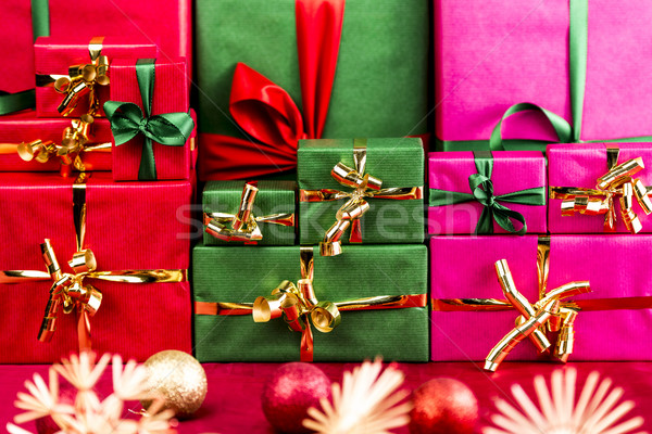 Three Stacks of Xmas Presents Arranged by Color Stock photo © leowolfert