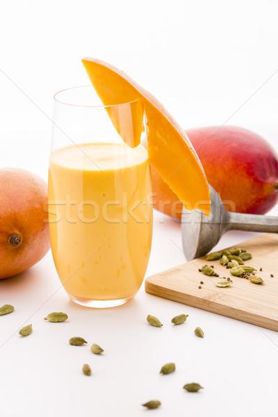 украшенный манго молочный коктейль стекла Cut фрукты Сток-фото © leowolfert