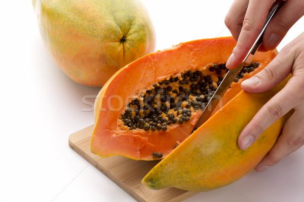 Papaya Cut In Half Along Its Longitudinal Axis Stock photo © leowolfert