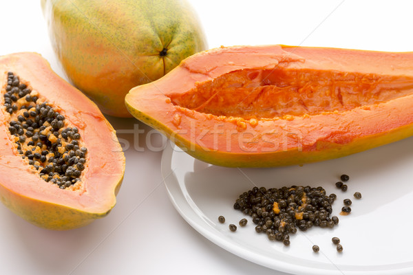 Hollowed Out Papaya Half And Its Peppery Seeds Stock photo © leowolfert