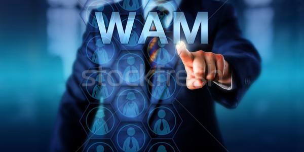 Recruitment Manager Pressing WAM Onscreen Stock photo © leowolfert