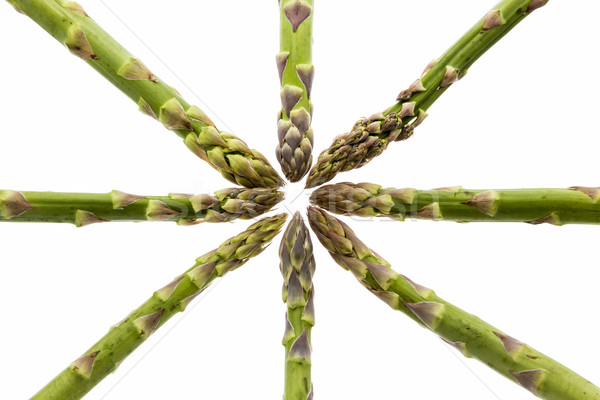 Eight Asparagus Spears Define the Center Stock photo © leowolfert
