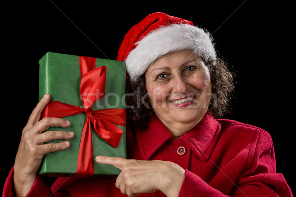 Happy Female Pensioner Pointing at Wrapped Gift Stock photo © leowolfert