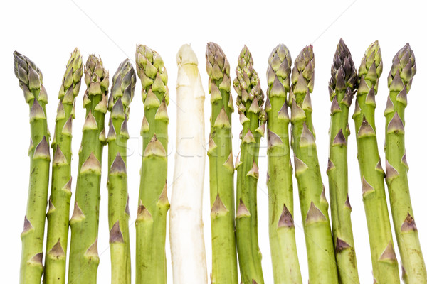 One White Asparagus Spear Among Twelve Green Ones Stock photo © leowolfert