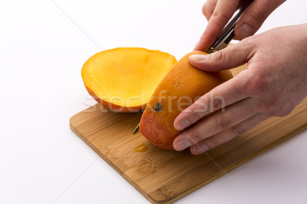 Third Of A Mango Sliced Off In A First Cut Stock photo © leowolfert