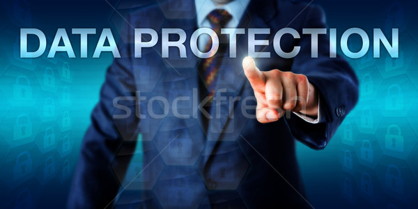 Manager Pushing DATA PROTECTION Onscreen Stock photo © leowolfert